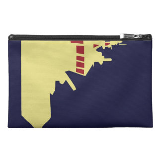 Yellow ship with red travel accessories bag