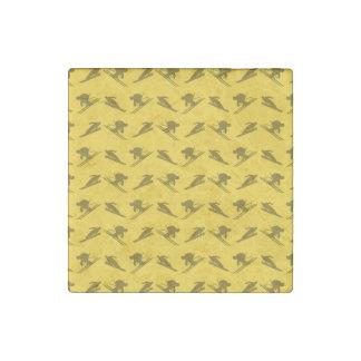 Yellow ski pattern stone magnet