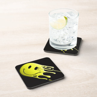 yellow smiley on black background drink coaster