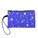 Yellow snowflakes and stars on blue sky change purse