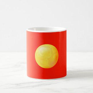 Yellow sphere on red coffee mug