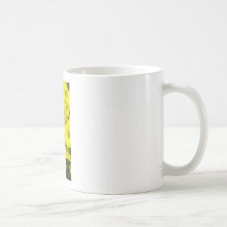 Yellow spring flowers in the garden coffee mug