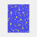Yellow stars float against night snowfall fleece blanket