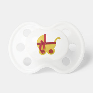 Yellow stroller, red bow, red button baby shower pacifier