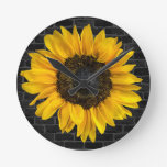 yellow sunflower on brick wall round clock