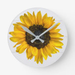 yellow sunflower on wood round clock