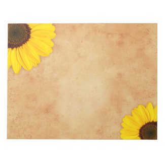 Yellow sunflowers on stained old paper notepad