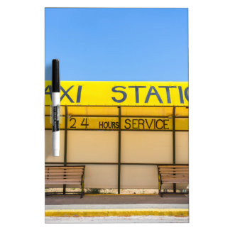 Yellow taxi station at coast in Greece Dry-Erase Board