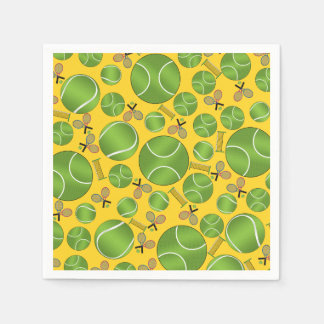 Yellow tennis balls rackets and nets paper napkins