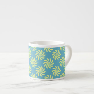 Yellow twirls on blue background espresso cup