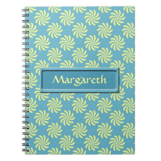 Yellow twirls on blue background note books