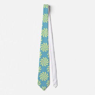 Yellow twirls on blue background tie
