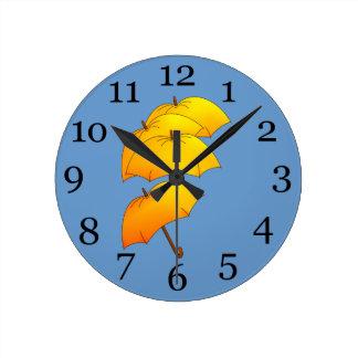 Yellow umbrellas round clock