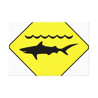 Yellow 'warning sharks' sign canvas print