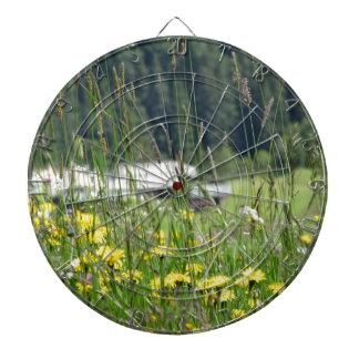 Yellow wildflowers on the meadow dartboard with darts