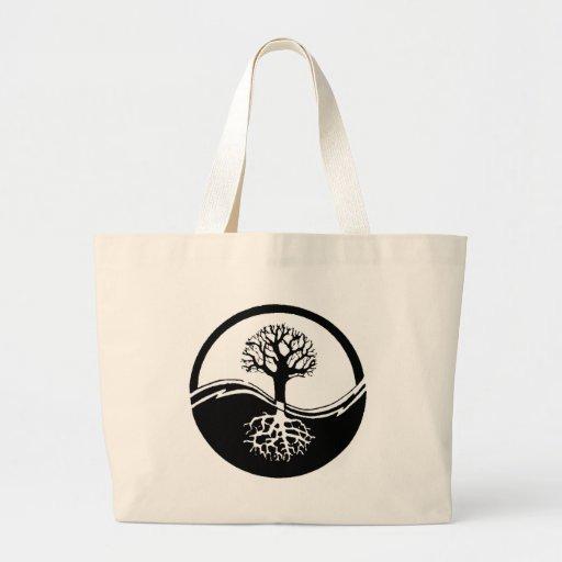 Yin and yang tree of life tote bags