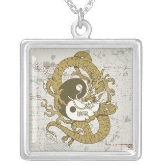 Yin yang Chinese symbol and dragon Pendants