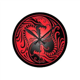 Yin Yang Dragons red and black Clocks