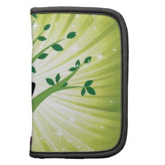 Yoga en verde con el árbol creciente planificadores