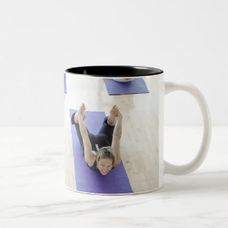 Yoga instructor leading class through the 2 Two-Tone coffee mug