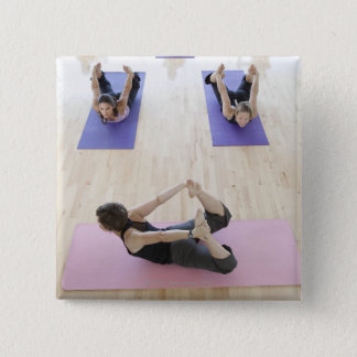 Yoga instructor leading class through the 2 pinback button