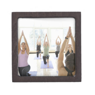 Yoga instructor leading class through the jewelry box