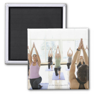 Yoga instructor leading class through the magnet