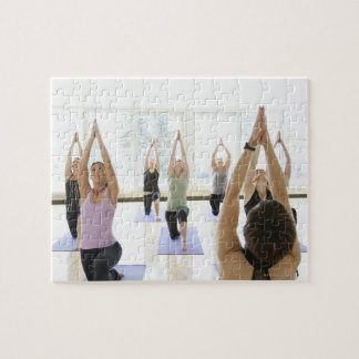 Yoga instructor leading class through the jigsaw puzzle