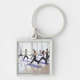 Yoga instructor teaching a class of women the keychain