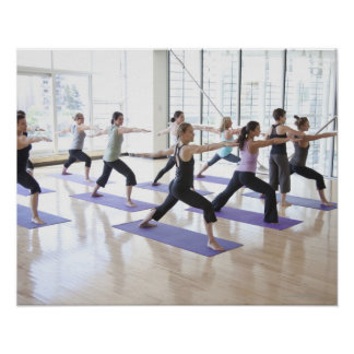 Yoga instructor teaching a class of women the poster