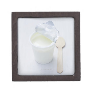 Yoghurt in opened disposable cup gift box