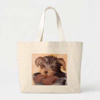 Yorkie en su taza bolsas de mano