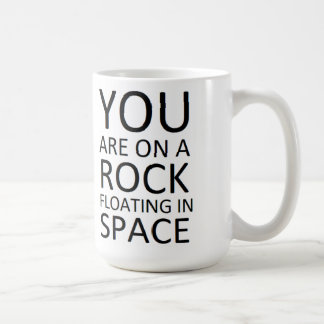You are on a rock floating in space classic white coffee mug