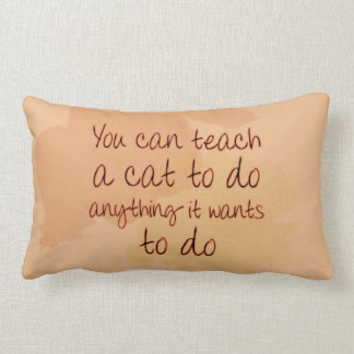 You can teach a cat to do anything it wants to do throw pillow