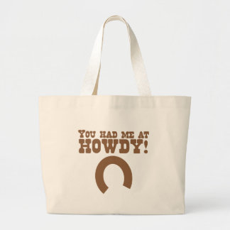 You had me at howdy! with a horseshoe large tote bag