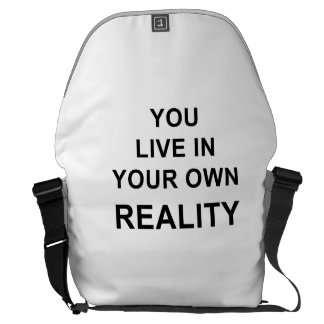 YOU LIVE IN YOUR OWN REALITY COURIER BAG