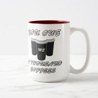 You owe me thousand coffees Two-Tone coffee mug
