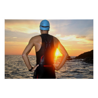 young athlete triathlon in front of a sunrise póster