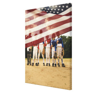 Young baseball players partially hidden by canvas print