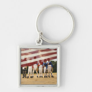 Young baseball players partially hidden by keychain