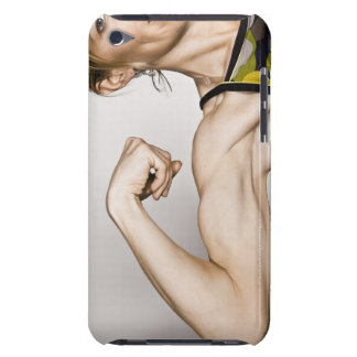 Young blond female flexes bicep muscle while iPod touch cover