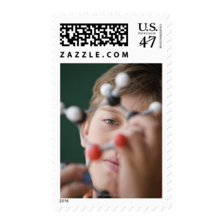 Young boy holding DNA model Postage