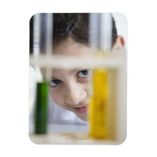 Young boy in chemistry science class, looking magnet