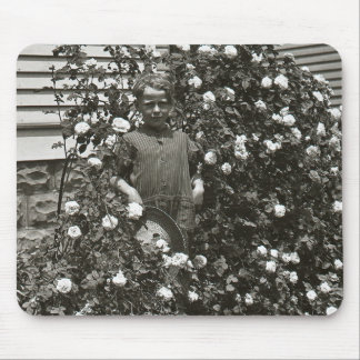 Young Boy in Rose Bush Mouse Pad