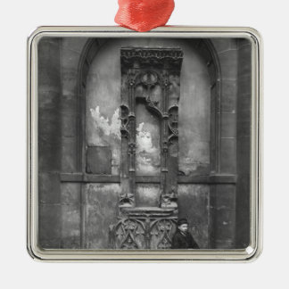 Young Boy Seated Outside Metal Ornament