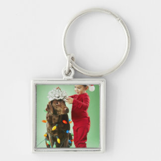 Young boy wrapping Christmas lights around a dog Silver-Colored Square Keychain