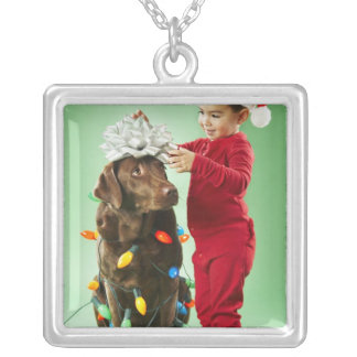 Young boy wrapping Christmas lights around a dog Silver Plated Necklace