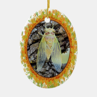Young cicada on branch in oval frame of leaves ceramic ornament