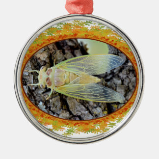 Young cicada on branch in oval frame of leaves metal ornament