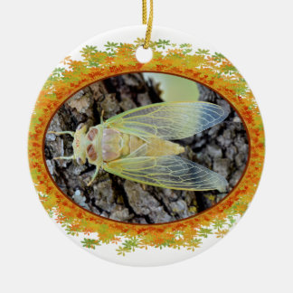 Young cicada on branch in oval frame of leaves christmas tree ornament